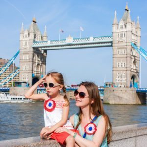 Mother and daughter in front of Tower bridge in London on Bastille day celebration